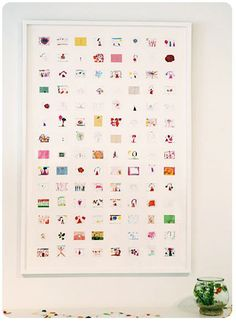 Great idea for saving your kids paintings and drawings - scan them and add them to one single page. Then frame the whole lot in a clean white frame. Original idea on Nine By Design - love me a little Novagratz style...