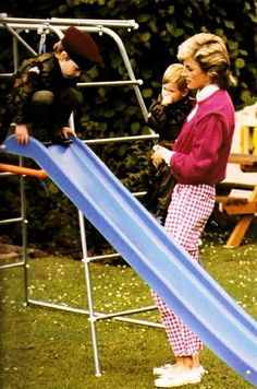 1986-07-18  Princess Diana and her boys Prince William and Harry in their playground at Highgrove, their country home in Gloucestershire