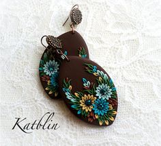 Polymer clay earrings made using the appliqué technique, by Katblin.