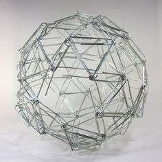 Spherical sculptures made out of paper clips and binder clips