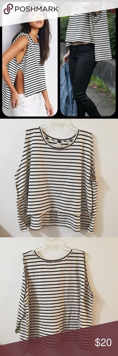 Free People Muscle Tee Black and white striped muscle tee by Free People is so unique and perfect for the 2017 stripe trend! Easy style and great for Coachella and other music festivals. Spring and summer look! Disclaimer: There is a small hole in the back, you barely notice it though. accepting offers Free People Tops Muscle Tees