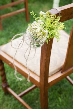 Sweet backyard wedding details.  Creative way to use a mason jar and spring flowers to decorate wedding aisle.  #weddingdecorations #flowers #masonjars  See more at: www.blossomblueblog.com