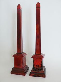Pair of hyalithe obelisks ; material called nowadays lithyaline of red and black colour. This material consists of  glass fully stained with copper & charcoal oxides mixed with cbone powder to give it the look of porcelain or gems. It was first manufactured in 1820 in Bohemia, Circa 1840 - Dim: H: 66 cm, W: 14.5 cm, D: 14.5 cm.