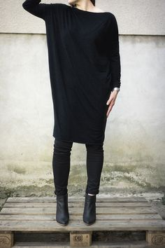 Dress in black organic cotton jersey.    Certified to GOTS -CU815672 Oversized dress. Day dress cotton. Raw edges. Slim sleeves. Loose fit. Lenght