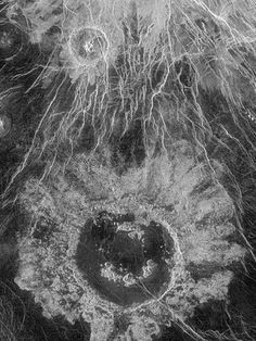 Wheatley Crater, Venus It snows metal there- and diamonds on Saturn. The wind on Neptune is so fast it breaks the sound barrier, and Jupiter has a storm that's 3x the size of Earth. Jupiter's Moon Europa has an ocean that's SIXTY MILES deep