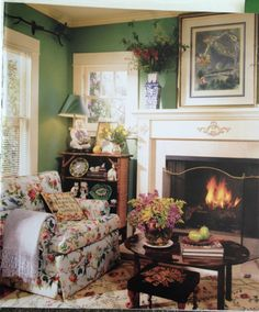 I may have decorated in red, blues and yellow, but I still love these English cottage colors and design!!!  Love this corner pic!