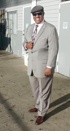 burg shoes, grey suit, pink shirt.