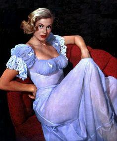 1950s-1960s Swedish actress Anita Ekberg wearing a baby blue negligee.