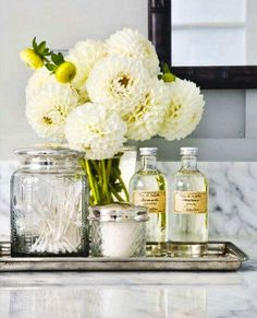 This is Glamorous - Sterling silver tray, vintage apothecary jars and marble top.