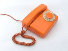 Vintage orange rotary telephone by ArtmaVintage on Etsy. $69.00, via Etsy.