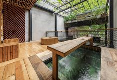 Koi Cafè & Spa is a one-of-a-kind venue featuring a small, self-contained ecosystem: a mix of green philosophy and harmonic nature