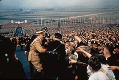 Color photo by Hugo Jaeger, Adolf Hitler's personal photographer, testify the enthusiastic embrace of the German people