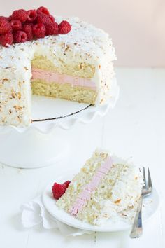 Coconut Cake with Raspberry Buttercream Filling and Coconut Marshmallow Frosting is an impressive dessert that everyone will love!