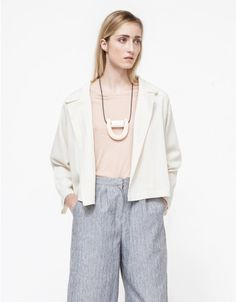 A lightweight, textured blazer from Objects Without Meaning with a modern, boxy silhouette. Features an open front, raglan sleeves, back vent and a relaxed fit through the torso.  •Textured blazer with boxy silhouette •Open front •Raglan sleeves