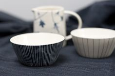 Made exclusively for Cloth and Goods in our colors; indigo stripes and brown dots, mugs and bowls. Hand thrown by a ceramicist using a cream color stoneware clay.