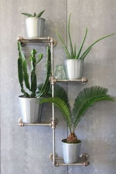 If you own a garden room then a tiered plant shelf is the perfect place to show off ferns and cacti. Choose a chunky industrial-style shelf, like this from Rockett St George, to keep the look contemporary. Find more ideas for an organised and streamlined Industrial Bathroom, Industrial Living, Industrial Shelving, Industrial Interiors, Industrial Storage Furniture, Quirky Bathroom, Pipe Shelving, Industrial Style Kitchen, Shelving Units