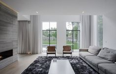 Minimalist Belgian Living room by Contekst - Photo: Nils Van Brabant