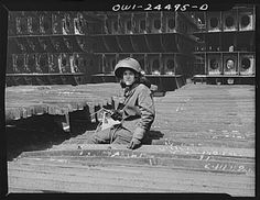 Bethlehem-Fairfield shipyards, Baltimore, Maryland. A woman #welder working on the sub-assembly of shell frames. From a Library of Congress collection.