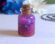 Iridescent Stars Galaxy in a Bottle Charm (red/purple) Bottle Jewelry, Bottle Charms, Bottle Necklace, Galaxy In A Bottle, Galaxy Jar, Jar Fillers, Astronaut Party, Mini Bottles, Mason Jar Crafts