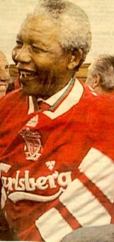 Nelson Mandela wearing a Liverpool Football Club jersey during the teams tour to South Africa