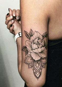 This is pretty much the idea of what I'm getting on my ribs, except the mandalas is more geometric and there's a deathly hallows symbol in the peony in negative space. #beautytatoos