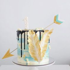 - Cake with Edible Arrow and Feather details  - Like if you want a taste! - Tag someone who would enjoy this!! - Cake by @sugarnoms_ -
