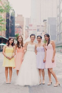bridesmaids in pretty pastels by http://www.donna-morgan.com/  Photography by mademoisellefiona.com