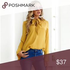 Bell sleeve bow tie blouse Sophisticated, chic and classic for the office or casual night out. Feminine bow tie. Polyester/Spandex blend. Brand new and I tagged from maker. Medium fits size 6-8. See size chart for measurements. The color is a gold/mustard. Tops Blouses