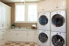 Cabinets above the machines - Fairytale Tudor - traditional - laundry room - minneapolis - by Eskuche Design