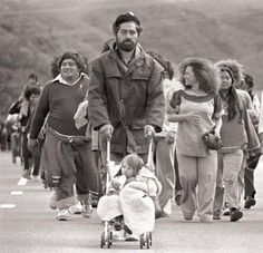 Maori Land Marcher Dave Ruru wheels his daughter, Tania along the Wellington Motorway  south of Porirua, Monday, 13th October, 1975