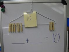 "Number bonds to 10 - using a coat hanger & pegs as a visual aid & practical support ("",)"