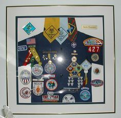 cub scout wall quilts | Cub Scout shirt/awards display idea