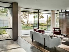 In the living area and elsewhere, glass walls swing open to let breezes sweep through.