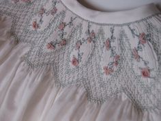 Babycakes is an advanced smocking design from Australian Smocking Magazine. Each row of smocking is painstakingly sewn and snipped over pleated fabric at the end of each little section! All embroidery and smocking is hand done. Roses and rose buds are embroidered in each panel all the