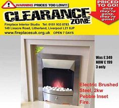www.fireplaces-liverpool.com  Reduced to £199 was £349 electric silver fire. Limited stock.