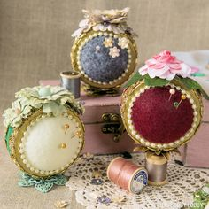"""Thess pin cushion projects are """"sew"""" sweet! We transformed mason jar lids into pin cushions using styrofoam balls and fabric accessories."""