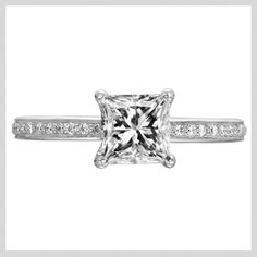 Ritani Classic engagement ring that features a prong set princess cut solitaire centerstone with a row of micropav diamonds set within the prongs and a single row micropav shank. Available at TWO by LONDON!