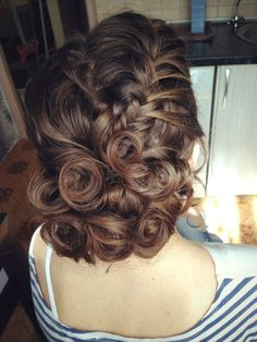 curly updo with a braid for medium hair