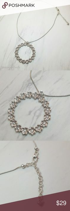 Brighton Silver Flower Crystal Circle Necklace Brighton Silver Flower Crystal Circle Necklace in excellent used condition. Some minor wear. All crystals are intact. Very pretty!  Please let me know if you have any questions. Happy Poshing! Brighton Jewelry Necklaces
