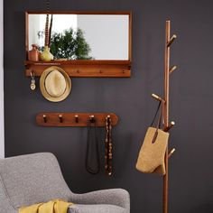 With 5 hooks for hanging anything from bags to outerwear, our Mid-Century Entryway Mirror adds a helping hand. Perfect for an entryway, hallway or foyer, it will keep you (and your space) organized.