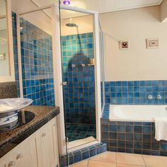Come and take a blue shower at Abalonen Lodge in Hermanus Beautiful Bathrooms, Corner Bathtub, Shower, Mirror, House, Furniture, Home Decor, Rain Shower Heads, Decoration Home