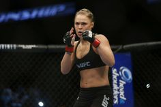 Ronda Rousey is the first-ever woman to sign with the Ultimate Fighting Championships (UFC) mixed martial arts company. In February, she beat fellow trailblazer Liz Carmouche in a historic UFC match.  Rousey is updating the face of female athletics through her tough skills and commercial successes.  Read more: Brandon Stanton | TIME 30 Under 30: World Changers | TIME.com http://ideas.time.com/2013/12/06/these-are-the-30-people-under-30-changing-the-world/#ixzz2myErK4Xw