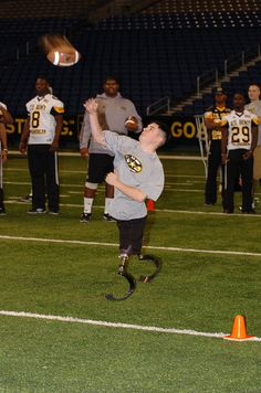 An extra effort for the team is given by a Brook Army Medical Center Wounded Warrior during the Jan. 4, 2012, Punt, Pass and Kick event at the San Antonio Alamodome during the US Army All American Bowl. Photo by Sgt. 1st Class Scott D. Turner, USAAC G7. For more images from the All American Bowl, check out the GoArmy's All American Bowl Flickr setwww.flickr.com/photos/goarmyphotos/sets/72157628386397295...