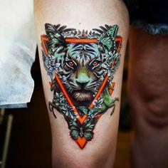 This tiger looks hungry. Tattoo by Caroline Friedmann #InkedMagazine #tiger #butterflies #tattoo #tattoos #Inked #ink #art