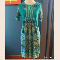 """Sandra Darren Printed Dress Sandra Darren printed dress featuring a keyhole neck. You will love the bright pattern that is perfect for summer. Measures: shoulder 15"""", chest 17"""", length 33"""". Material is 95% polyester, 5 % spandex- great stretch! Sandra Darren Dresses"""