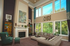 Living room view, picture windows, fireplace - The Ellsworth Model at Maybury Park Estates by Cranbrook Custom Homes