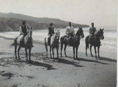 Four horses & their riders on Torrance Beach. Circa 1920's.