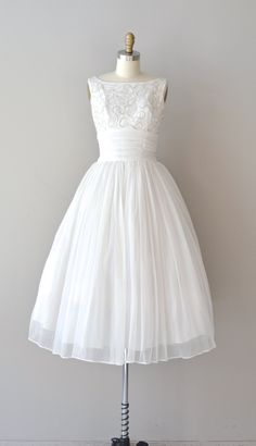 vintage 1950s, early 1960s wedding dress with iridescent sequin soutache bodice, princess seams, shirred chiffon cummerbund-style fitted waist and full layered chiffon skirt. metal back zipper. ✂-----Measurements    fits like: small  bust: 34  waist: 26  hip: free  length: 47  brand/maker: n/a  condition: excellent    ✈ NOTE: this item ships Priority Mail both domestically & internationally    to ensure a good fit, please read the sizing guide:  http://www.etsy.com/shop/DearGolden/policy…