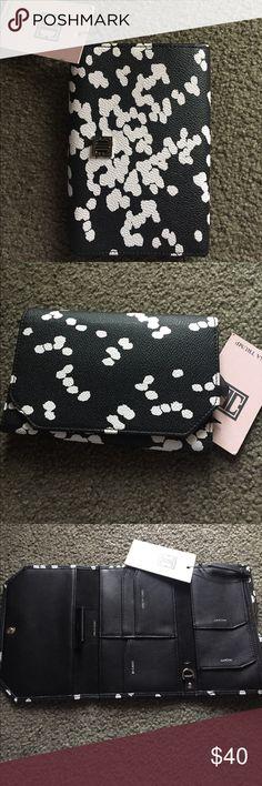Ivanka Trump Rio Small travel wallet Ivanka Trump Small travel wallet in black and white. New with tags Ivanka Trump Bags Wallets