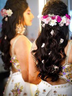Check this stunning white lehenga styled with multicoloured daisies and baby's breath.    #Indianweddings #shaadisaga #indianbridalhairstyles #hairstyleswithflowers #intimatewedding #realflowers #uniquecolourlehenga #babybreaths #lowbun #exoticflowerhairstyle #carnations #daisies Indian Bridal Hairstyles, Bride Hairstyles, Easy Hairstyles, 60 Year Old Woman, 4b Hair, Bridesmaid Hair, Bridesmaid Ideas, Bridesmaids, Square Faces